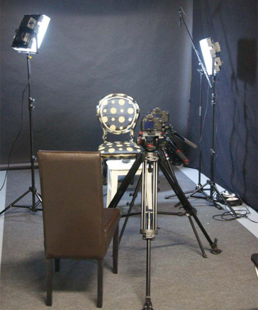 A chair, a camera and spotlights
