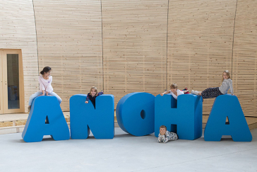 Children gymnastics on the lettering ANOHA