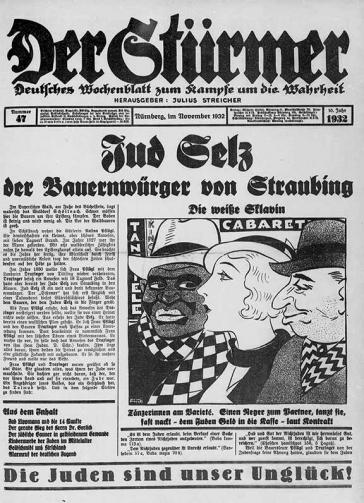 """Titelblatt der Hetzschrift """"Der Stürmer"""". Unter anderem zu sehen sind eine antisemitische und rassistische Karikatur und am unteren Rand der Seite der von Heinrich von Treitschke geprägte antisemitische Claim """"Die Juden sind unser Unglück!"""""""