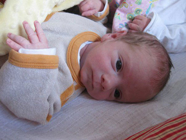 Baby practising the sign of priesterly blessing
