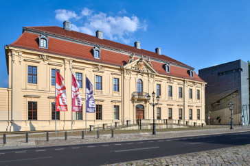 Baroque old building of the Jewish Museum Berlin with colorful flags