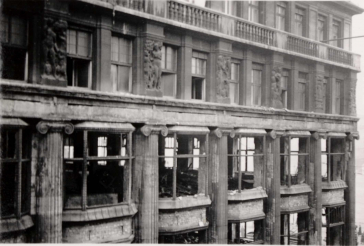 The photo shows a building with destroyed windows and the devastation inside the first two floors of the department store. The photo was taken on the 2nd floor, presumably from the opposite building.