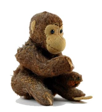Brauner Plüschaffe mit beweglichen Armen und Beinen, schwarzen Knopfaugen, Gesicht, Hände, Füße und Ohren aus Filz