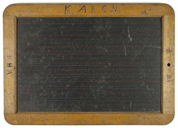 A blackboard with wooden frame with the inscription K. Aron