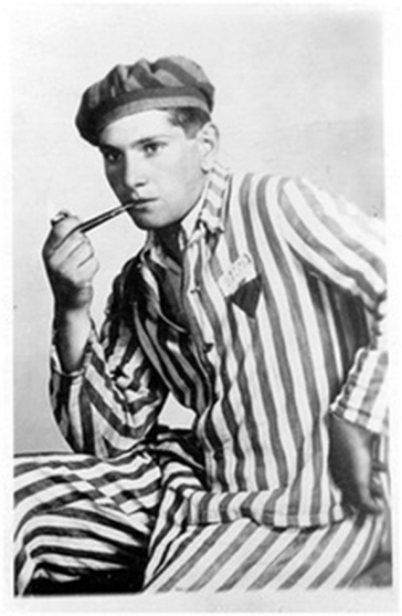 Young man in prisoner's uniform, casually smoking a pipe