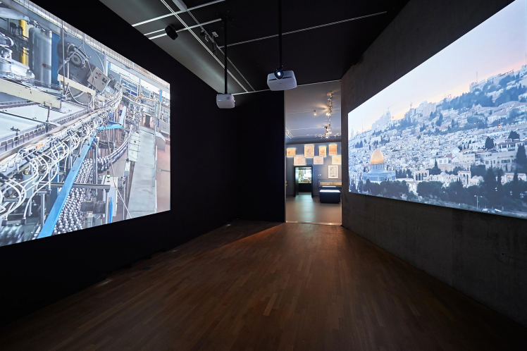 Exhibition room with two films playing on two large screens