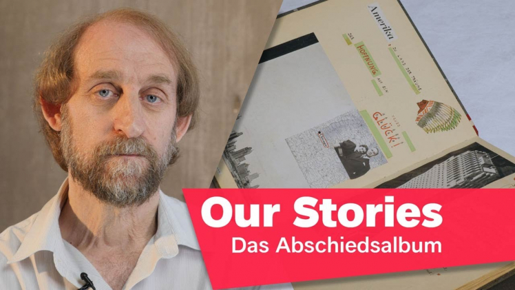 """Portrait photo of Aubrey Pomerance, in the background an opened album, in the lower right corner of the picture the inscription """"Our Stories: Das Abschiedsalbum"""" (The Family Album)."""