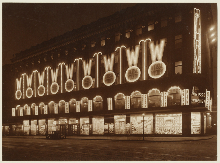 Black-and-white photograph of the department store at night