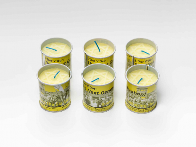 Six yellow candles with, a pale Magen Daved on top, in yellow tin cans.