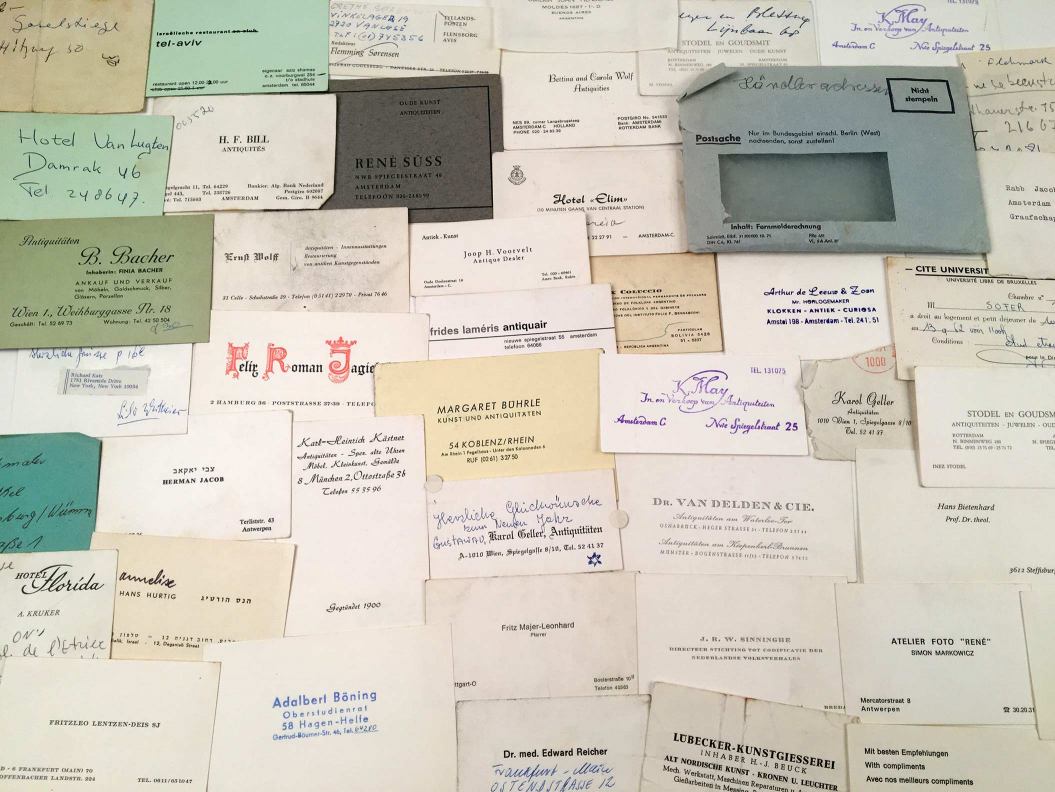 Many business cards arrayed on a table