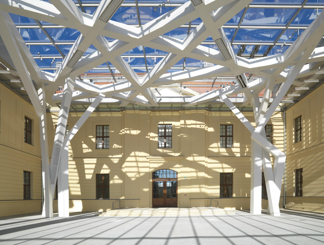 The inside of the Glass Courtyard of the Jewish Museum Berlin; the roof windows create shadows on the floor