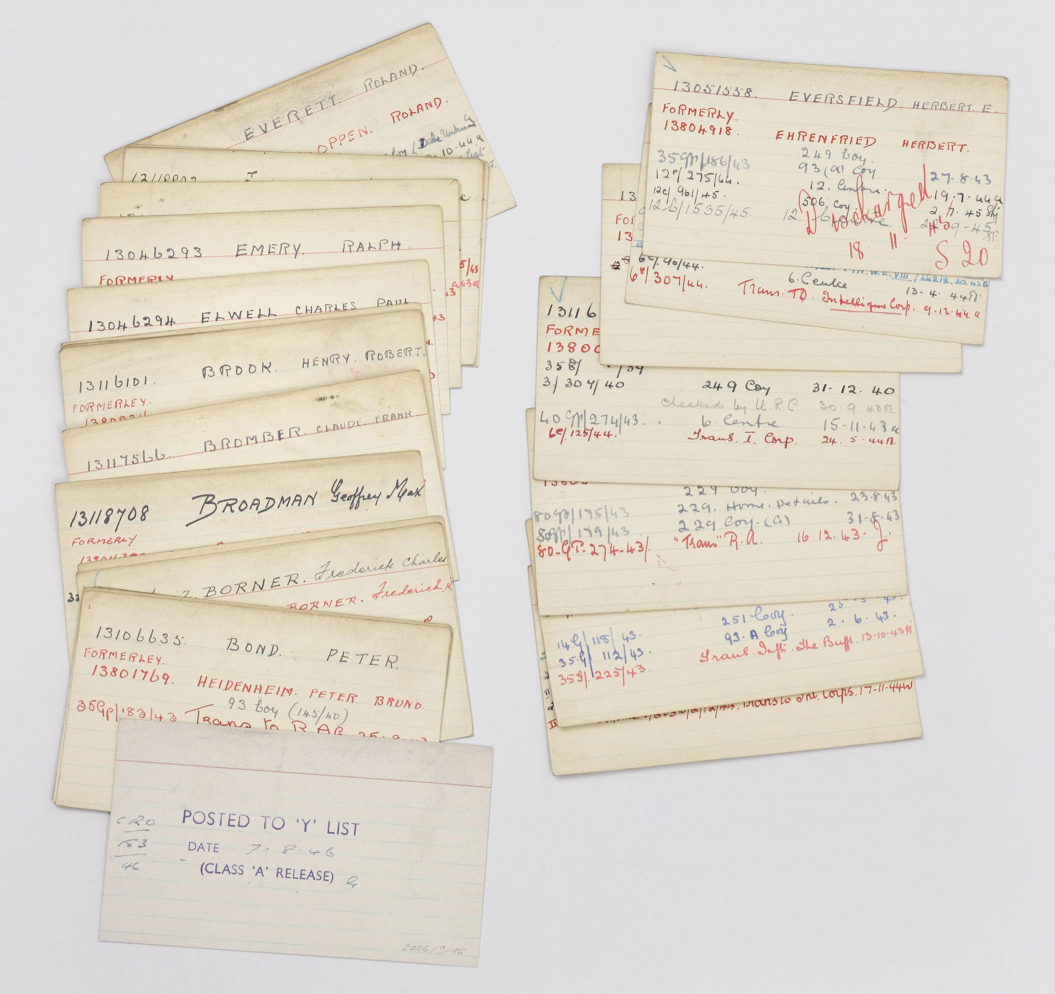 Two spread-out stacks of labelled index cards