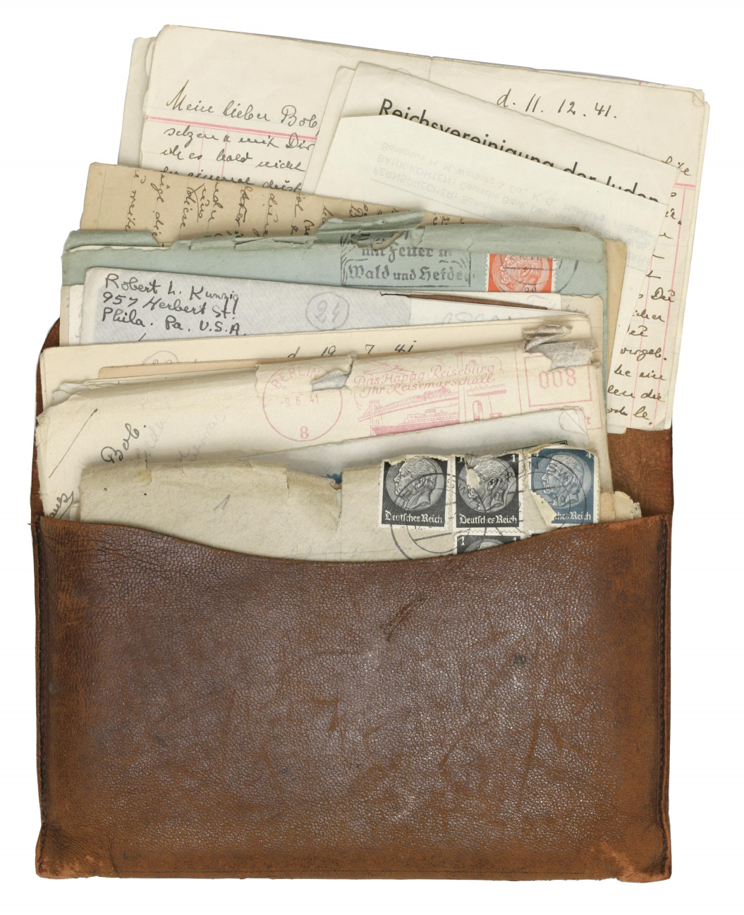 Photo of a leather pouch filled with letters