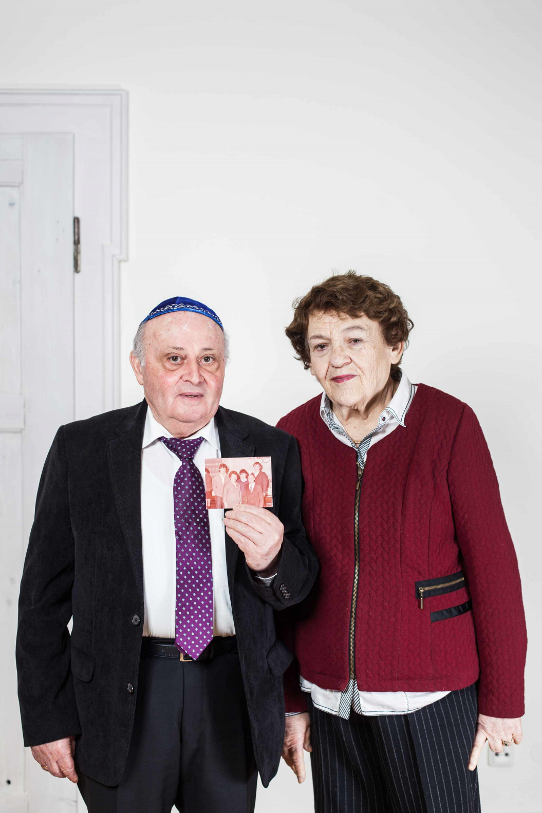 Older couple with a photograph in their hands