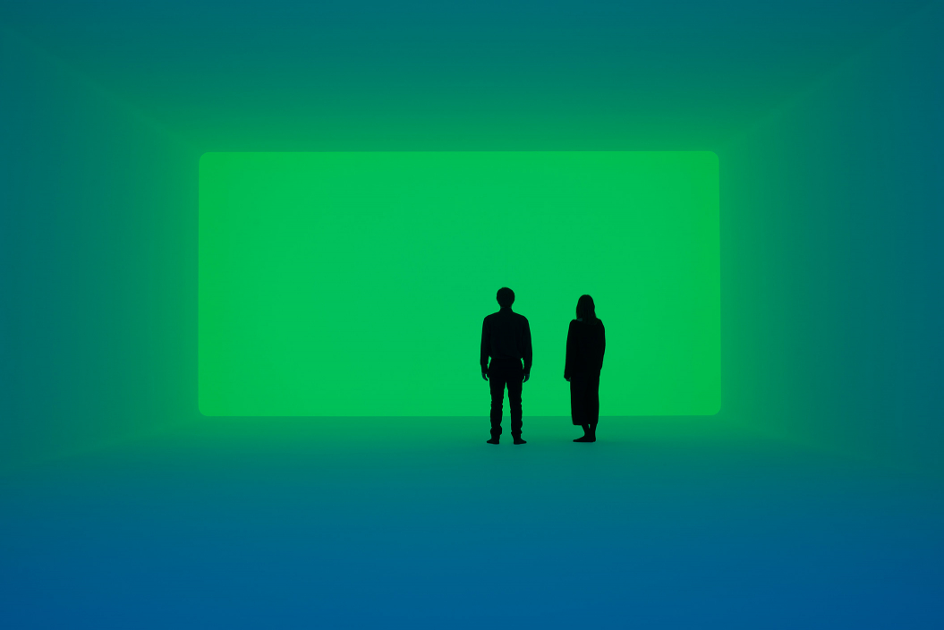 A man and a woman stand in a room flooded with green light