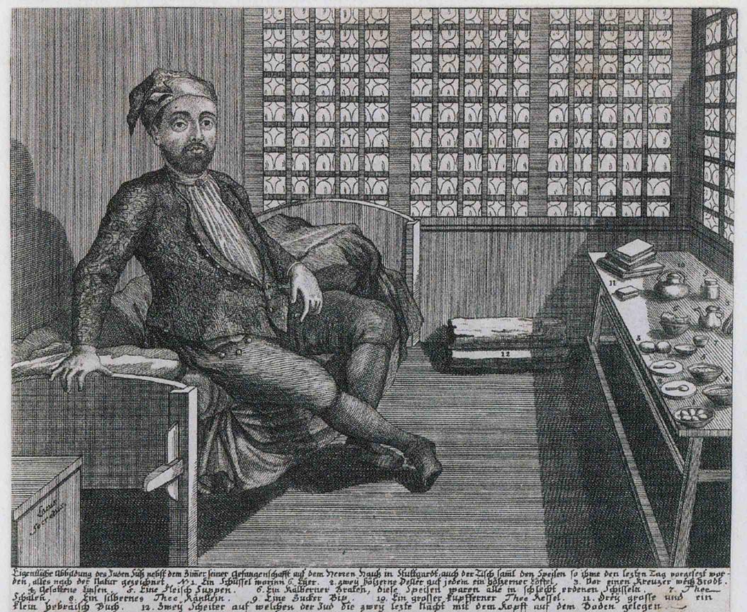 Ein Mann mit leerem Blick sitzt auf einem Bett in einer Zelle