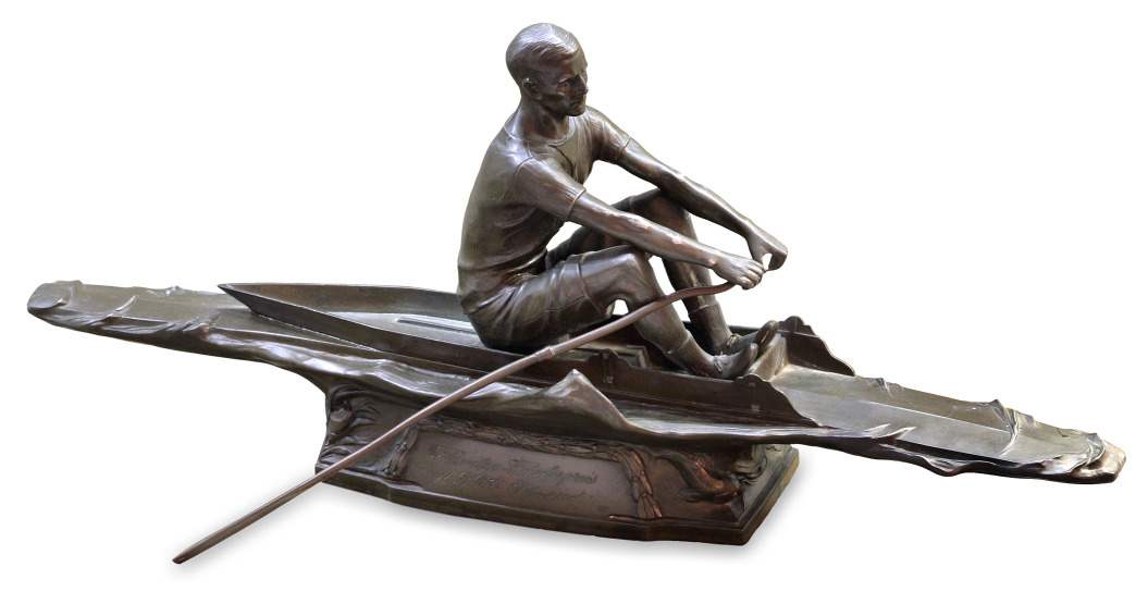 Bronze sculpture of a man rowing