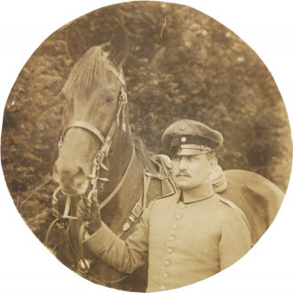 ´Black-and-white photograph: Uniformed soldier with horse