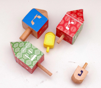 Five dreidels made of different materials
