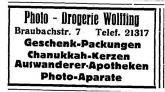 """An old drugstore ad from a newspaper for """"emigrées-pharmacies"""" and chanukkah-candles."""