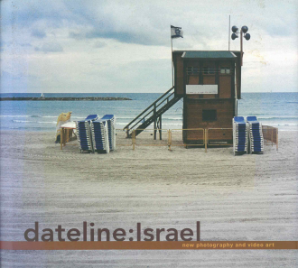"Book Cover of ""Dateline: Israel"": a small wooden building next to the beach, the building is flying the flag of Israel and is surrounded by stacks of beach chairs"