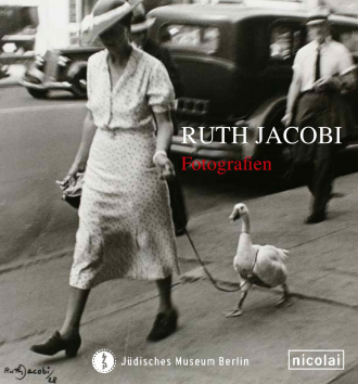"Catalouge Cover for exhibition ""Ruth Jacobi"": black and white photograph of a woman with a large hat walking a white duck on a leash"