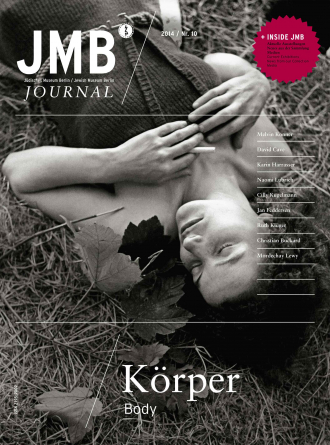 "Cover of ""Body"", Journal Ten: black and white photo of a woman smiling with her eyes closed laying down in in the grass and leaves"