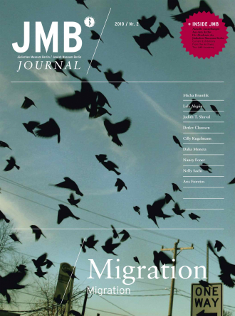"Cover of ""Migration"", Journal Two: a flock of black birds flying through the sky"