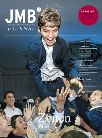 "Cover of ""Times"", Journal Nine: a smiling young boy in a suit being lifted into the air by a group of people below"