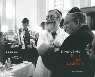 "Book Cover for ""Russen - Juden - Deutsche"": black and white photograph of two older men wearing Yamaka holding a small crying baby"