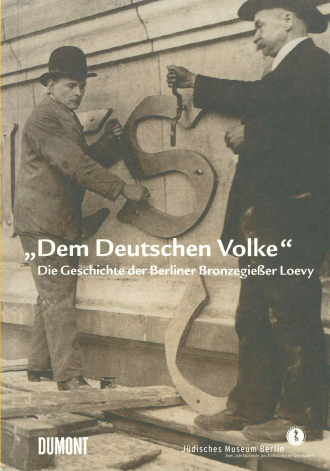 """Book Cover of """"Loevy"""": black and white historical photograph of two men with tools standing next to a large metallic """"S"""""""