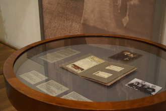 Display case in the permanent exhibition featuring the Lustig family wedding album