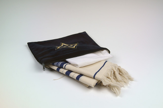 A Tallit (prayer shawl) with tzitzit (tassels)