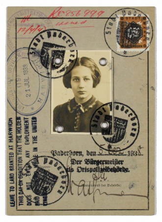 Childhood passport with photo and many stamps