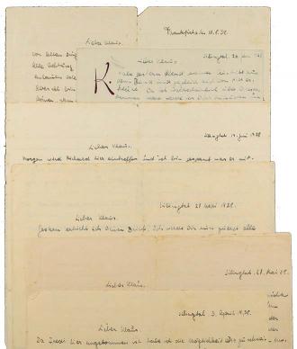 Several handwritten, overlapping letters