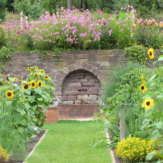 garden with stone wall and flowers
