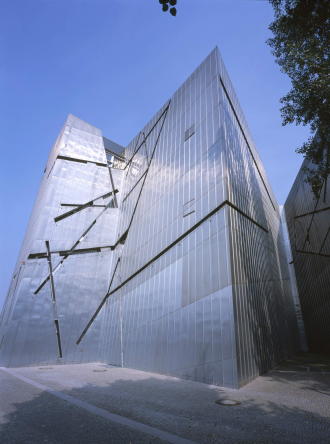 An upward view of the Libeskind Building during a sunny day