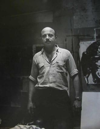 Boris Lurie, standing