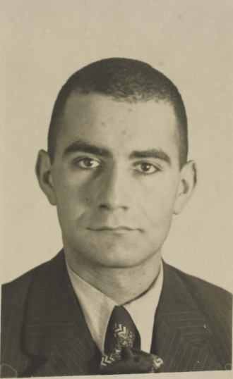 The photograph shows Josef Hochfeld with shorn hair and a sad look on his face.