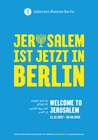 "Poster with ""Jerusalem is now in Berlin"" written on it. The ""u"" is replaced with a menorah."