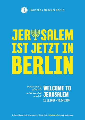 """Plakat mit der Aufschrift """"Jerusalem ist jetzt in Berlin"""", wobei das u durch eine Menora ersetzt ist"""