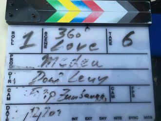 "Label on the clapperboard: ""Roll 1 - 360° Love - Take 6 -Medea -Dani Levy -Filip Zumbrunn"""