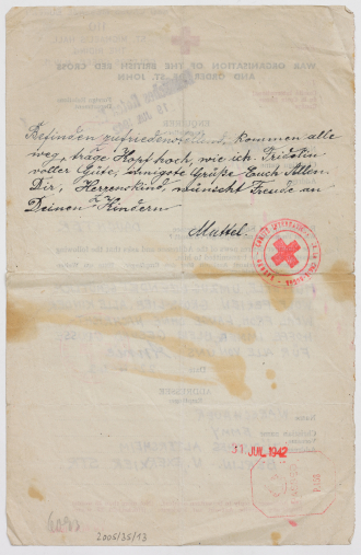 Reverse side of the Red Cross letter with a handwritten note