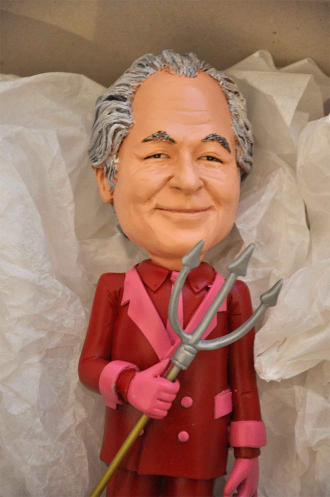 Bernie Madoff-doll with silver hair and a pitchfork