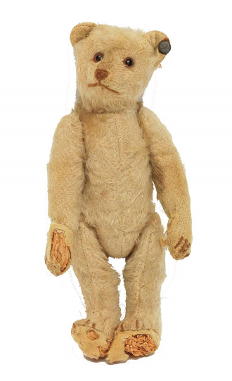 "Light brown teddy bear from the Steiff company with the manufacturer's trademark ""button in the ear."""