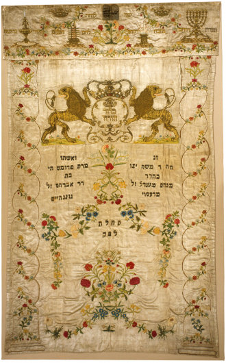 Embroidered Torah curtain with crest, roses, and Hebrew lettering