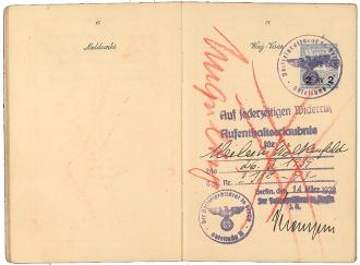 Aufgeschlagener Pass mit rot durchgestrichenem Aufenthaltserlaubnis-Stempel