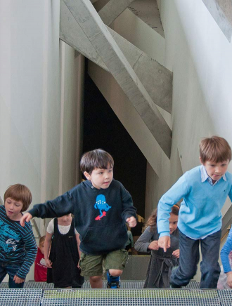 Children running up a staircase