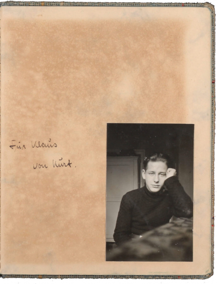 Yellowed page with handwritten dedication alongside black-and-white photo of a teenaged boy
