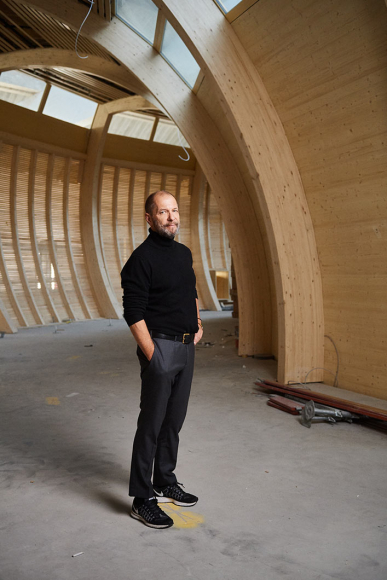 Architect Alan Maskin stands inside the ark